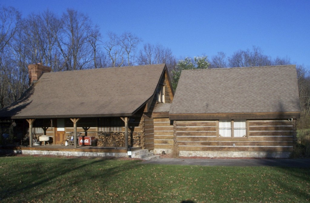 Projects old kentucky logs concrete log siding for Concrete log cabins